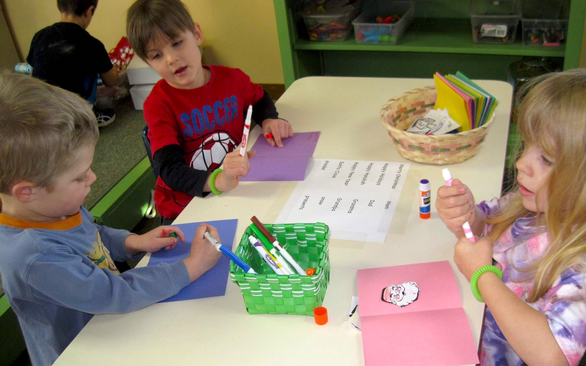 Two preschoolers at Discovery Trails Early Learning Academy choosing colorful beads for an art project.